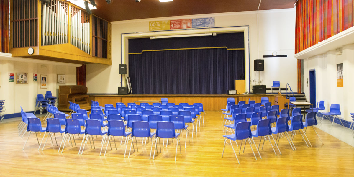 Auditorium with stage and sound booth for hire.